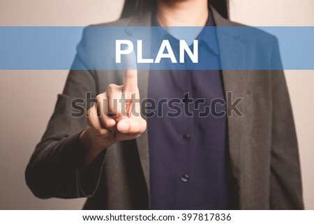 woman finger pointing at the camera with plan word - stock photo