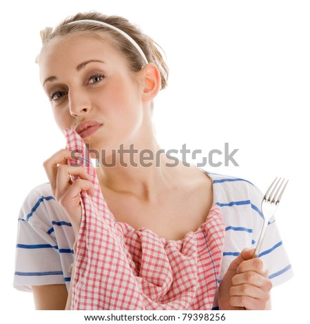 Woman finishing her lunch and wiping her mouth with napkin - stock photo