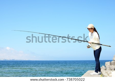 Woman fishing at sea