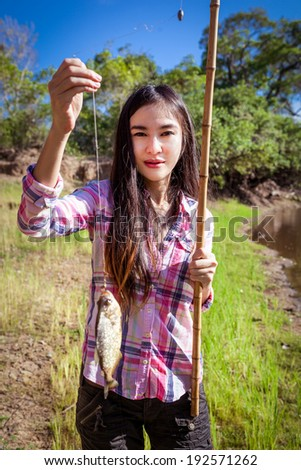 Woman fishing Piranha - stock photo