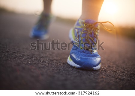 Woman fitness, Runner feet running - stock photo