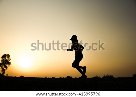 Woman fitness silhouette sunrise jogging workout wellness concept. - stock photo