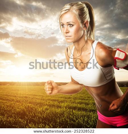 Woman fitness workout - running wheat field - stock photo