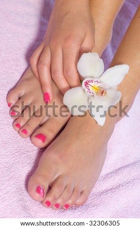 woman foot with orchid