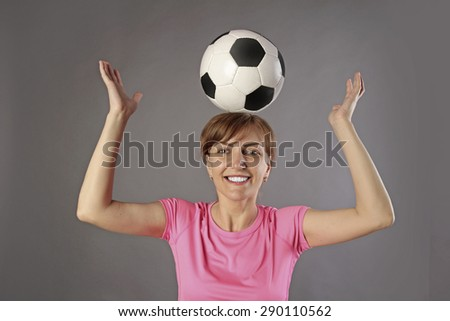 woman football player with ball