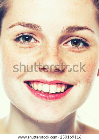 Woman freckle happy young beautiful studio portrait with healthy skin - stock photo
