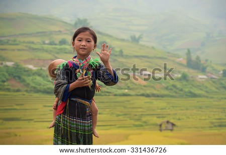 Woman from black hmong hill tribe, children girl smile,Tu Le Lao Cai,Vietnam.
