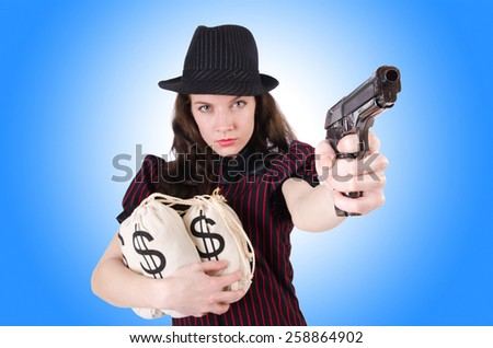 Woman gangster with gun and money - stock photo