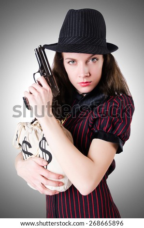 Woman gangster with handgun on white - stock photo
