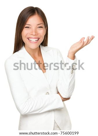 woman gesturing / showing. Businesswoman in white suit smiling looking at camera explaining with gesture. Beautiful young mixed race woman professional isolated on white background. - stock photo