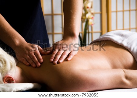 woman getting a good massage at a day spa - stock photo