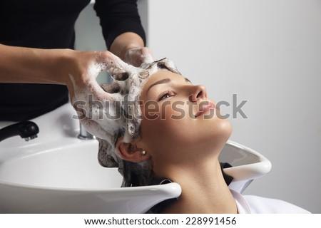 woman getting a hair wash procedure in salon