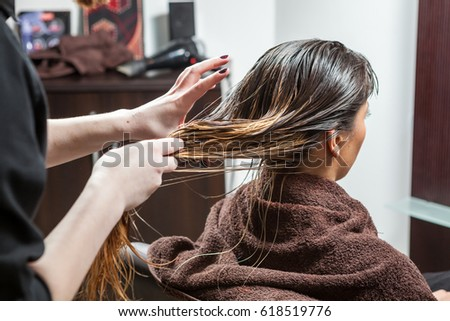 Woman getting a hairstyle in salon. Professional service. Beauty and treatment