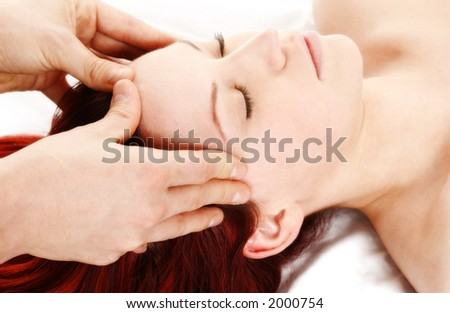 woman getting a head and shoulder massage - stock photo