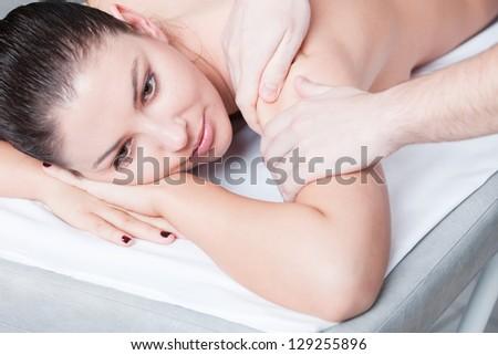 Woman getting body massage at spa salon - stock photo