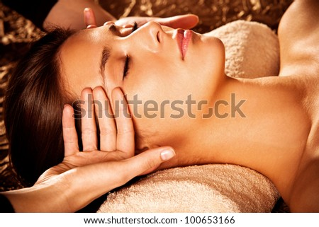 woman getting  face  massage in spa