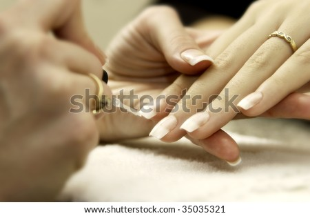 woman getting manicure - stock photo