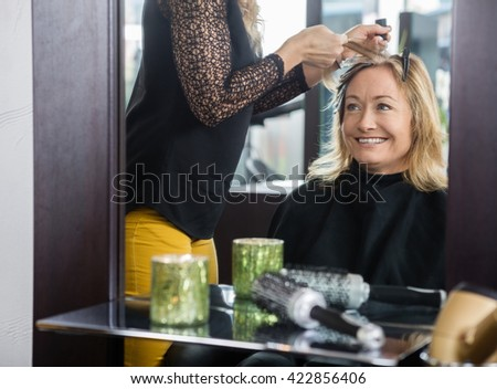 Woman Getting New Hairstyle In Beauty Parlor - stock photo