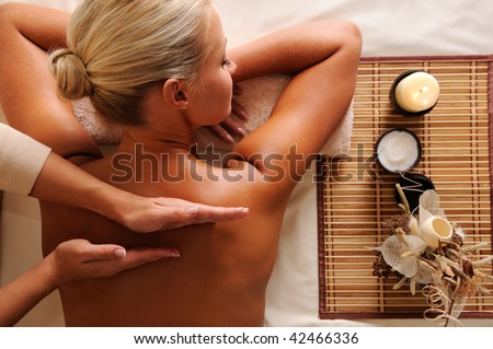 Woman getting  recreation massage in spa salon - high angle - stock photo