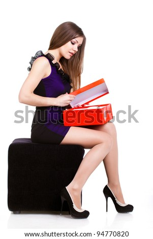 Woman getting shoes as gift or happy of her shopping. Asian woman surprised and happy to receive red high heels shoes as a present. Isolated on white. - stock photo