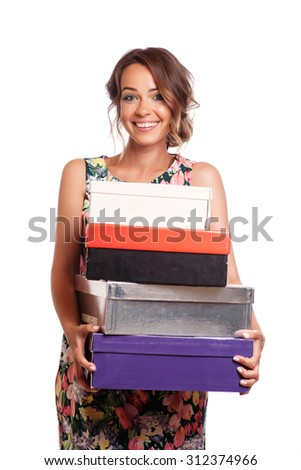 Woman getting shoes. Young beautiful woman surprised and happy to receive boxes with shoes - stock photo
