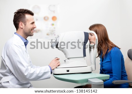 Woman getting visual field test done by the optometrist - stock photo