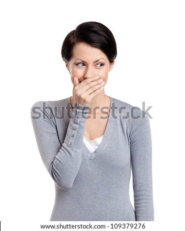 Woman giggles covering her mouth with hand, isolated on white