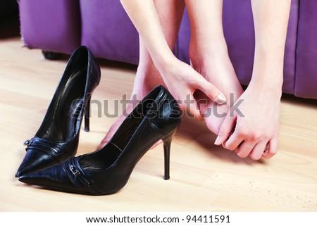woman give herself foot massage - stock photo