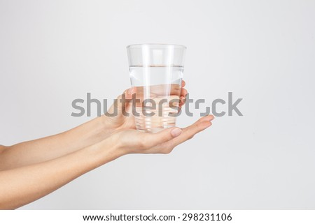 woman giving a glass with water to patient - stock photo