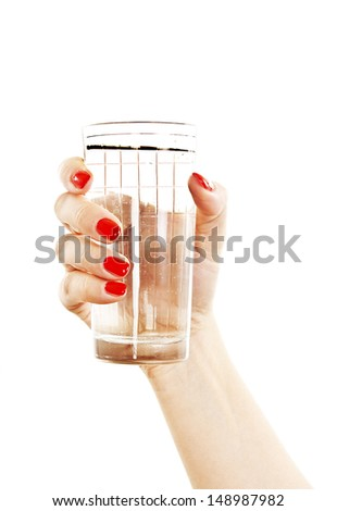 Woman giving a glass with water to patient. Isolated on white background - stock photo