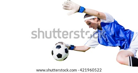 Woman goalkeeper stopping a goal - stock photo