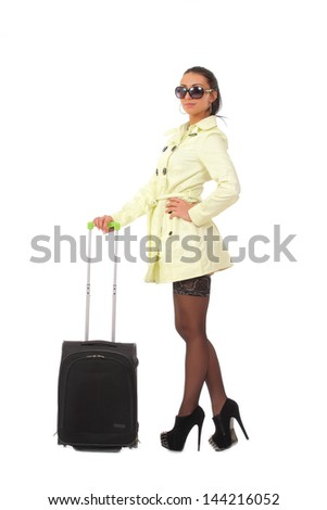 woman going on holiday with suitcase - stock photo