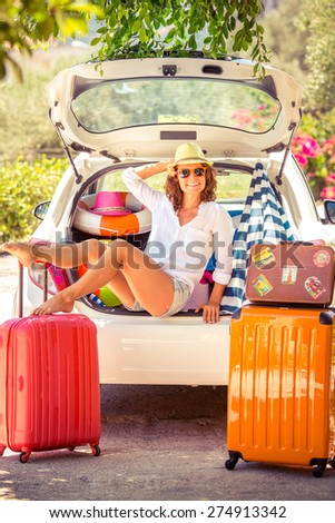 Woman going on summer vacation. Car travel concept - stock photo
