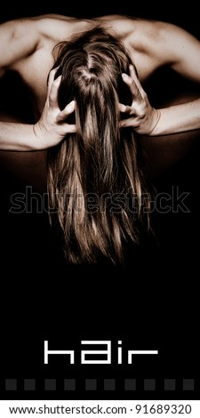 Woman Grabbing Her Beautiful Long Hair with text space below - stock photo