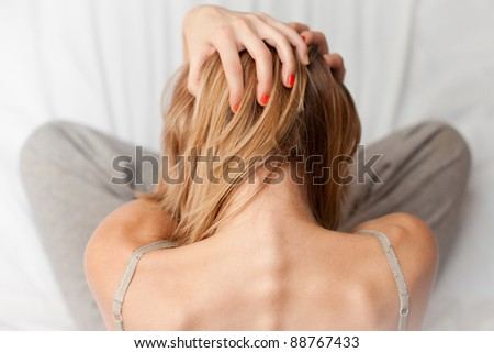 Woman Grabs Her Head - stock photo