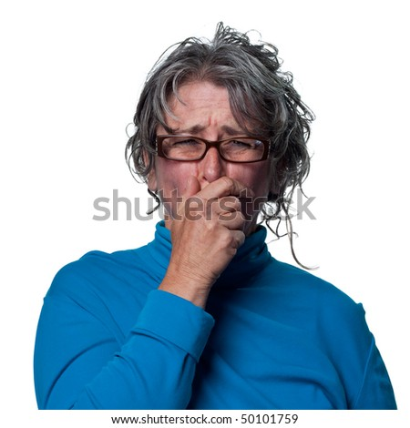 woman grimacing after eating something unsavory - stock photo