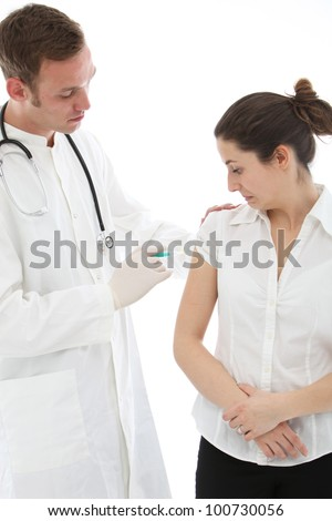 Woman grimacing as she receives an intramuscular injection in her upper arm from a doctor, nurse, or student intern - stock photo