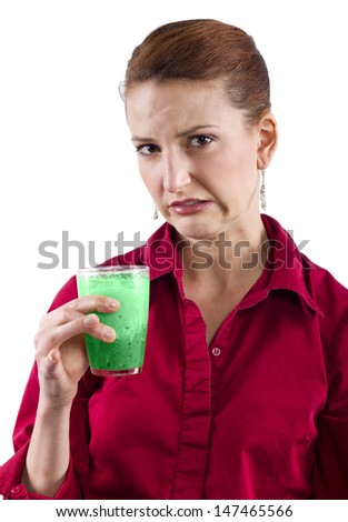 woman grossed out by green vegetable juice - stock photo