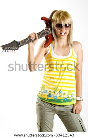 woman guitarist holding the guitar on her shoulder - stock photo
