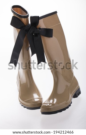 woman gum boots on white  - stock photo