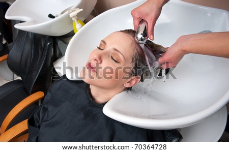 woman hair washed in salon pool