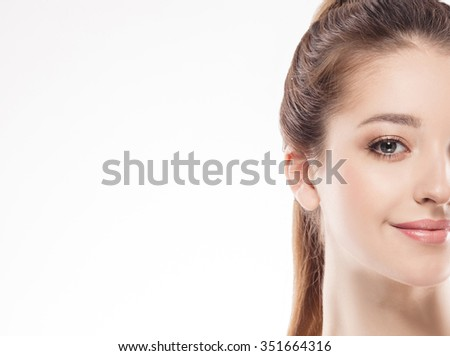 Woman half-face young beautiful healthy skin portrait - stock photo