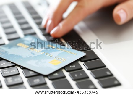 Woman hand and credit card on laptop, closeup - stock photo