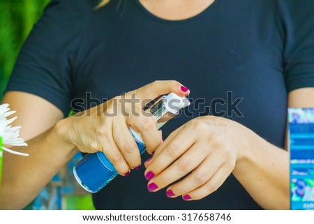 Woman hand applying cream on the other hand