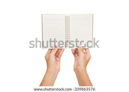 woman hand carrying an empty notebook isolated on white background - stock photo