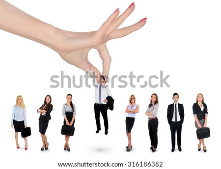 Woman hand choosing business man - stock photo