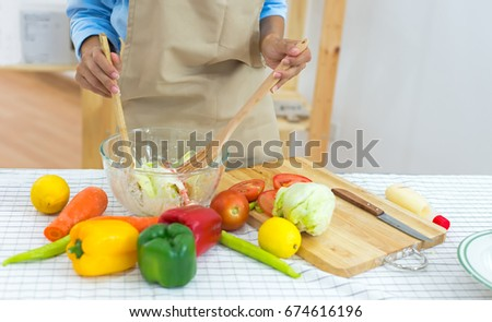 Woman hand cook make mix vegetables salad on kitchen for diet.  Healthy Concept