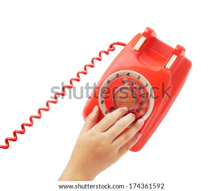 Woman hand dialing number on telephone - stock photo