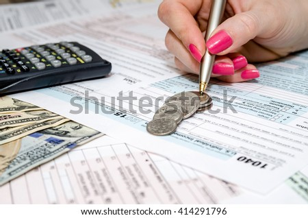 woman hand filling in individual return tax form