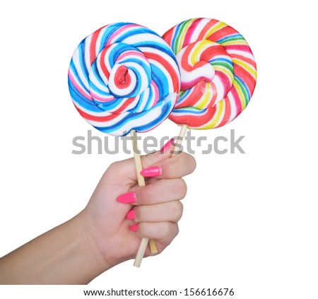 Woman hand golding two lollipops - stock photo